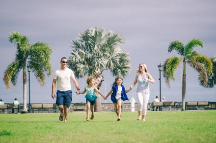 A family running in Riverfront Park in Cocoa Village