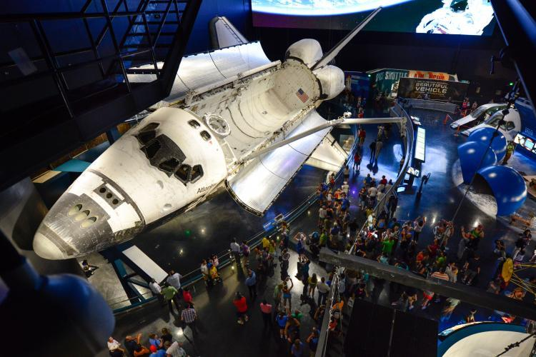 The Space Shuttle Atlantis with bay doors open on display at Kennedy Space Center