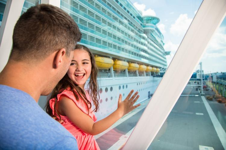 A very excited dad and daughter boarding a cruise ship at Port Canaveral
