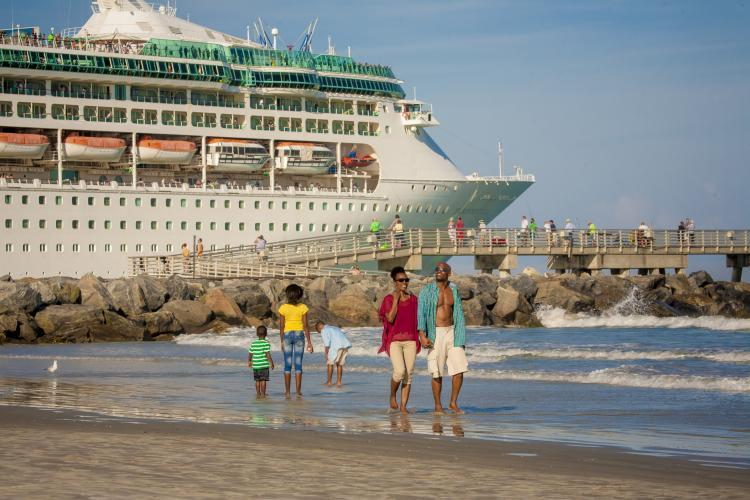 A cruise ship sails by Jetty Park in Cape Canaveral